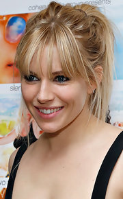 Sienna kept her beauty look au naturel with a fresh clear lip gloss.