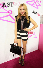 Peyton List kept it breezy and cute in a black-and-white romper during the JustFab ready-to-wear launch.