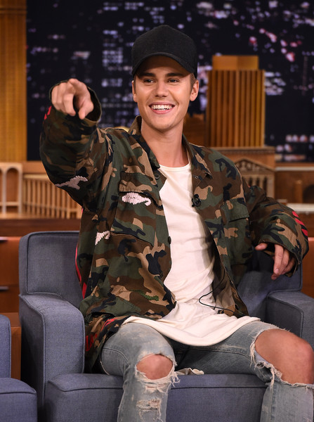 Justin Bieber Military Jacket [justin bieber,the tonight show starring jimmy fallon,military camouflage,camouflage,soldier,military,military uniform,army,fashion,uniform,design,sitting,new york city,rockefeller center]