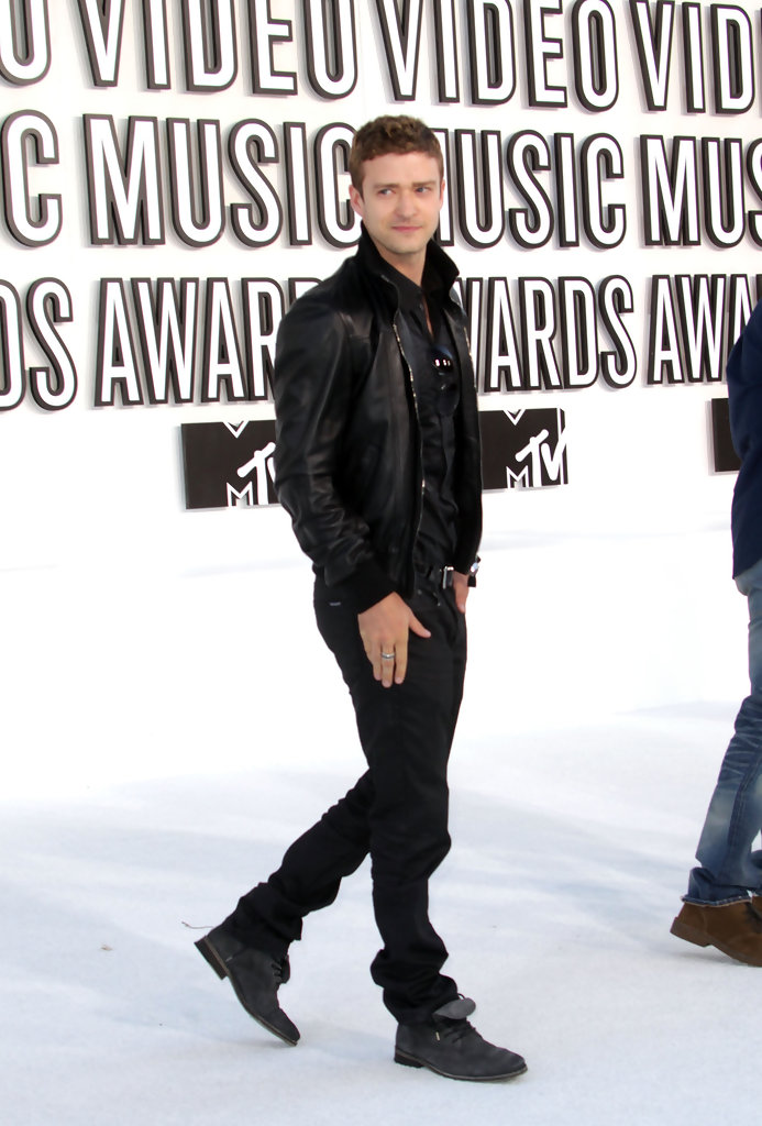 3e6e338c640 Justin Timberlake paired his black leather jacket and black tuxedo shirt  with black distressed boots. Lace Up Boots
