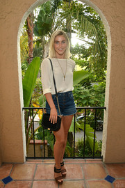 Julianne Hough kept it simple at the KEEP Collective Accessories social in a white blouse with rolled-up sleeves.