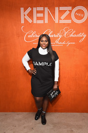 Danielle Brooks completed her black-and-white look with a slogan clutch.