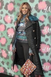 Iman accessorized with a cheetah clutch by Kenzo x H&M to finish off her print-centric look during the collaboration's launch event.