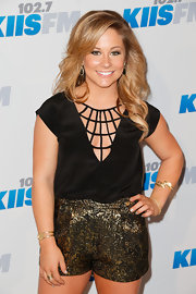 Shawn Johnson added some shimmer to her Jingle Ball outfit with a pair of metallic gold shorts.