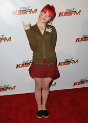 Hayley wore a plaid peated mini with a leopard print belt and olive green zip up.