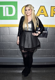 Meghan Trainor was edgy-girly in a black leather jacket layered over a metallic mini dress during Kiss 108's Jingle Ball.
