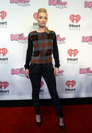 Iggy Azalea styled her sweater with a pair of studded black skinnies.