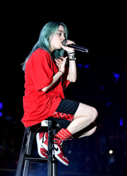 Billie Eilish coordinated her outfit with a pair of red, white, and black high-top sneakers by Nike.