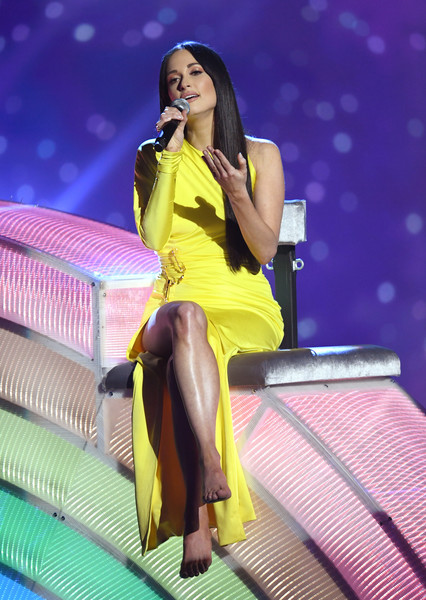 Kacey Musgraves Evening Dress [thigh,performance,leg,black hair,yellow,performing arts,music artist,fashion,long hair,human leg,kacey musgraves,iheartradio music awards,stage,commercial use,theater,california,los angeles,fox,microsoft,show]
