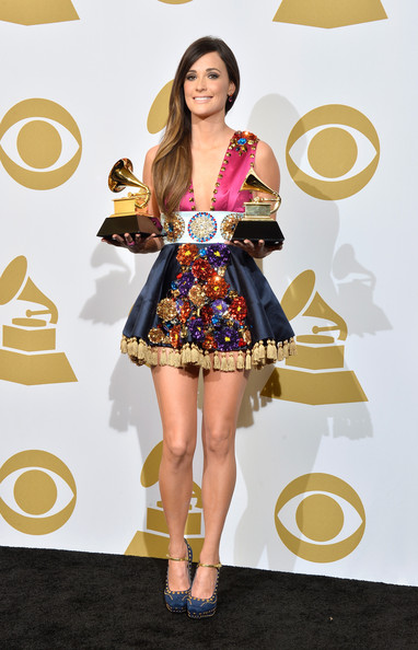 Kacey Musgraves Studded Heels [clothing,yellow,dress,fashion model,fashion,cocktail dress,red carpet,footwear,carpet,shoulder,kacey musgraves,winner,best country album award,best country song award,room,same trailer different park,staples center,press room,56th grammy awards,merry go round]