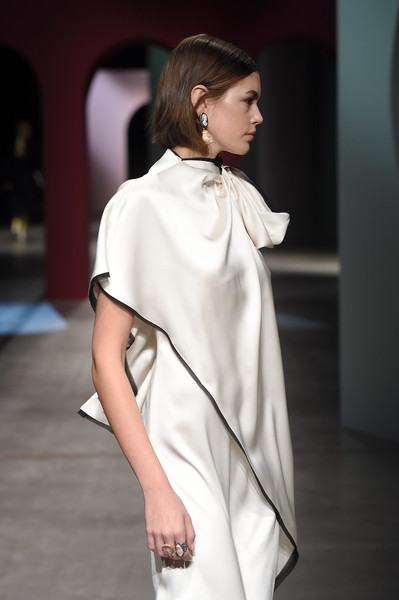 Kaia Gerber Statement Ring [fashion model,clothing,white,fashion,fashion show,shoulder,runway,beauty,fashion design,neck,kaia gerber,part,runway,milan,italy,ports 1961,milan fashion week,fashion show,milan fashion week fall,runway,fashion,fashion show,supermodel,haute couture,model,socialite,trench coat]