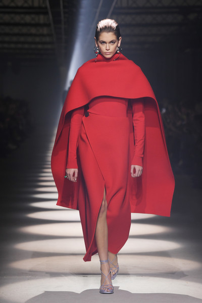 Kaia Gerber Cape [fashion,red,clothing,fashion show,fashion model,outerwear,runway,mantle,haute couture,fashion design,kaia gerber,runway - paris fashion week womenswear fall,part,runway,paris,france,givenchy,runway,fashion show,fashion,haute couture,model]