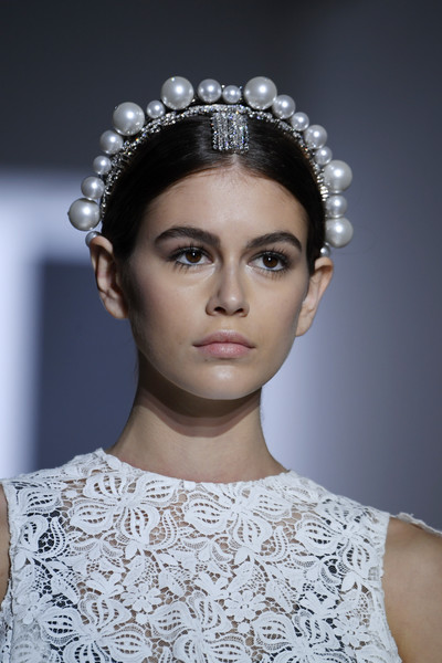 Kaia Gerber Classic Bun [haute couture spring summer,hair,headpiece,hair accessory,fashion,clothing,fashion model,hairstyle,eyebrow,beauty,haute couture,kaia gerber,part,runway,givenchy spring summer 2019,paris,france,givenchy,paris fashion week,show]