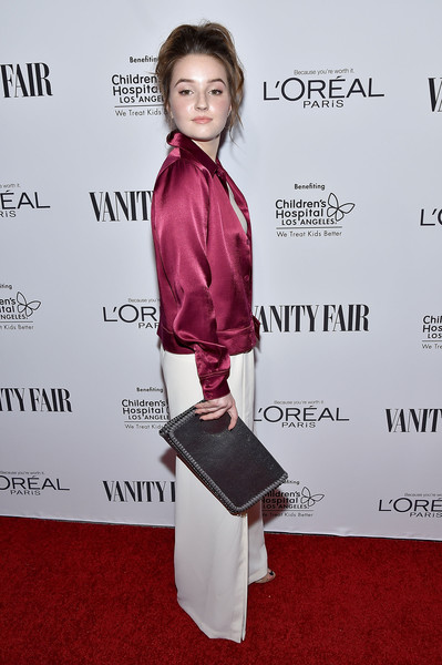 Kaitlyn Dever Leather Clutch [hairstyle,fashion,shoulder,red carpet,carpet,joint,flooring,suit,premiere,magenta,vanity fair,loreal paris,dj night,west hollywood,california,palihouse holloway,hailee steinfeld,kaitlyn dever]