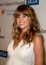 Sarah Wright chose a bright pink lip color to add some color to her pout.