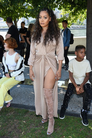 La La Anthony showed off some thigh in a nude wrap dress by Meshki during the Yeezy season 4 fashion show.