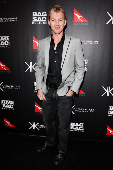 Brett Lee wore Dove Gray blazer with black piping on the lapels at the handbag launch of the Kardashian sisters in Sydney.