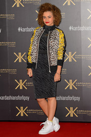 Little Nikki went for an eclectic look with this mixed-print zip-up jacket and patterned LBD combo at the Kardashian Kollection for Lipsy launch.