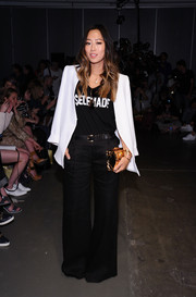 Aimee Song brought a '70s vibe to the Karen Walker fashion show with these black bell-bottoms.