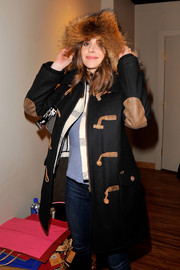 Alison Brie was spotted at Kari Feinstein's Style Lounge wearing a chic fur-trimmed toggle coat.