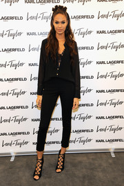 Joan Smalls looked subtly sexy at the Karl Lagerfeld Paris x Elle event in a black blouse unbuttoned halfway down to reveal a lacy bra.