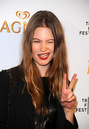 Behati Prinsloo's long center-parted hairstyle had a hippie feel.