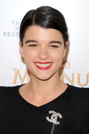 Crystal Renn styled her hair into a side-parted ponytail for the 2011 Tribeca Film Festival.