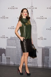 Eugenia Silva looked ultra stylish in a green and black leather dress by Coach during the label's boutique opening in Madrid.