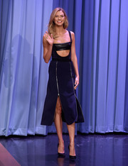 Karlie Kloss dared to bare in a black David Koma zipper-detailed midi dress complete with a bralette while making an appearance on 'The Tonight Show Starring Jimmy Fallon' in NYC.
