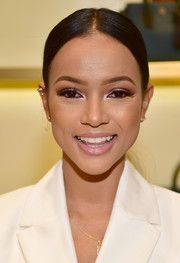Karrueche Tran topped off her look with a sleek center-parted ponytail for the MCM Atlanta store opening.