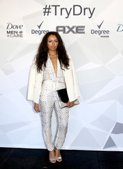 Kat Graham looked perfectly styled in a crisp white blazer layered over a studded jumpsuit at the Unilever ice skating event.