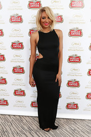 Kat Graham chose a sleek column dress with side cutouts for her look at the Stella Artois Suite in Cannes.