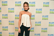 Kate Beckinsale looked flirty and chic in a floaty white strapless top by Solace London while visiting 'The Elvis Duran Z100 Morning Show.'