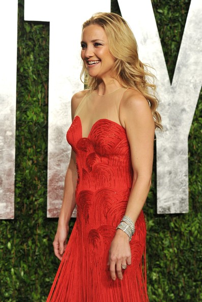 Kate Hudson Diamond Bracelet [oscar party,vanity fair,dress,clothing,shoulder,red,gown,strapless dress,cocktail dress,a-line,carpet,red carpet,west hollywood,california,sunset tower,kate hudson,graydon carter - arrivals,graydon carter]