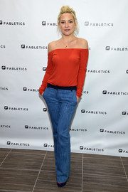 Kate Hudson was casual-chic in a red off-the-shoulder top —  the Fabletics Sonny Long Sleeve Tee — at the opening of the new Fabletics boutique.