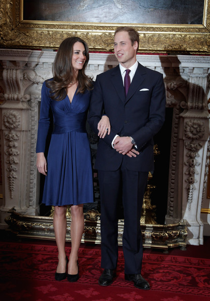 Kate Middleton Cocktail Dress [photographs,suit,formal wear,dress,tuxedo,standing,gown,flooring,gentleman,carpet,fashion,prince william,kate middleton,couple,clarence house announce the engagement of prince william,engagement,speculation,air sea rescue pilot,state apartments of st james palace,england,catherine duchess of cambridge,engagement announcement dress of catherine middleton,prince william duke of cambridge,wedding of prince william and catherine middleton,dress,clothing,wedding dress of catherine middleton,clarence house,william catherine: a royal romance,blue]