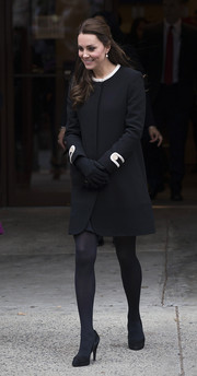 Kate Middleton sported a retro-chic black Goat coat with white piping for her meeting with Chirlane McCray.