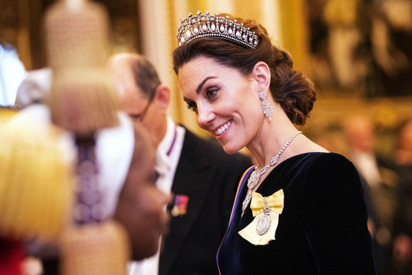 Kate Middleton Chignon [yellow,headpiece,beauty,lady,fashion,event,hair accessory,tiara,tradition,fashion accessory,tiara,royals,diana,catherine,guests,duchess,buckingham palace,cambridge,diplomatic corps,reception,catherine duchess of cambridge,tiara,british royal family,royal family,the queen,princess,royal family order,jewels of elizabeth ii,jewellery,diana princess of wales]