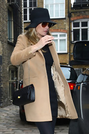 Kate Moss carried an elegant black quilted leather bag while visiting a London jewelry shop.