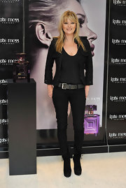 Kate Moss promoted her new fragrance in a pair of black suede ankle boots. She paired the on-trend boots with black skinny jeans.