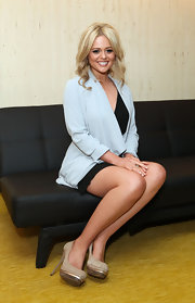 Emily Atack launched her new album while wearing a pair of beige suede pumps featuring metallic gold platforms.