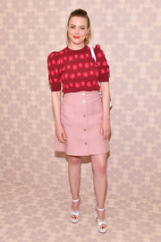 Gillian Jacobs looked sweet in a red floral knit top at the Kate Spade Spring 2019 show.
