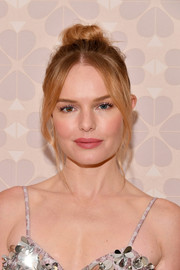 Kate Bosworth styled her hair into a top knot with face-framing tendrils for the Kate Spade Spring 2019 show.