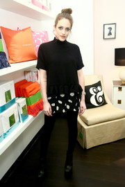 Carly Chaikin donned a loose black peplum top for the Kate Spade New York Housewarming event.