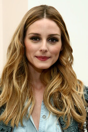 Olivia Palermo wore her hair down in a cascade of waves at the Kate Spade New York Housewarming event.