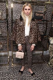 Zosia Mamet coordinated her suit with a pair of bowed leopard-print slippers, also by Kate Spade.