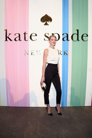Lindsay Ellingson attended the Kate Spade New York presentation looking stylish in a black-and-white jumpsuit.