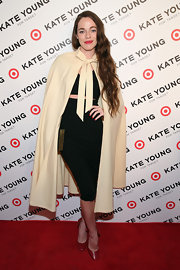 Hailey Gates chose a cool retro-style cape to pair with her black pencil skirt and crop top while at the Kate Young for Target launch.