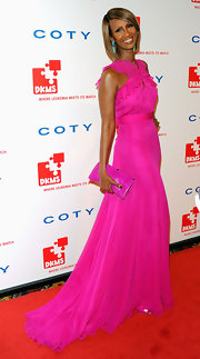 Iman simply wowed us at the DKMS Gala wearing Jason Wu's hot pink chiffon gown. The super model committed to the hue with a matching vibrant clutch. Iman played with contrast with a pair of turquoise shoulder-duster earrings peeking out from under her sleek chin-length bob.