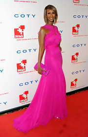 Iman showed off her svelte figure in a bright pink dress at the DKMS gala in NYC. The model maven paired the gown with a matching bright pink clutch.